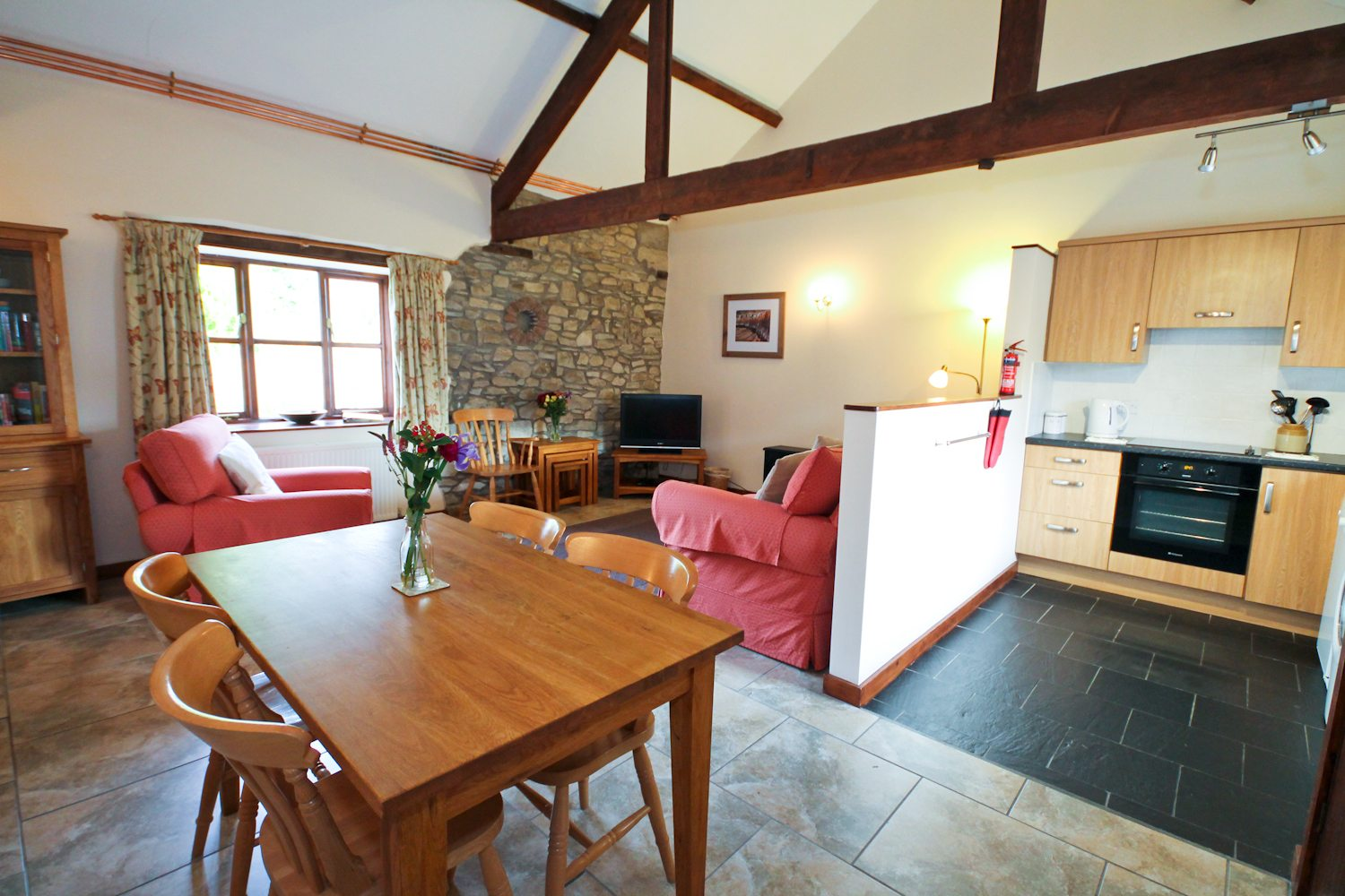 Open plan kitchen, dining and lounge at the Stable Cottage